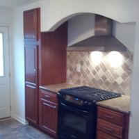 warm wood kitchen with modern range hood