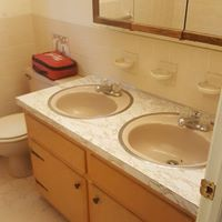 before bathroom with double sinks
